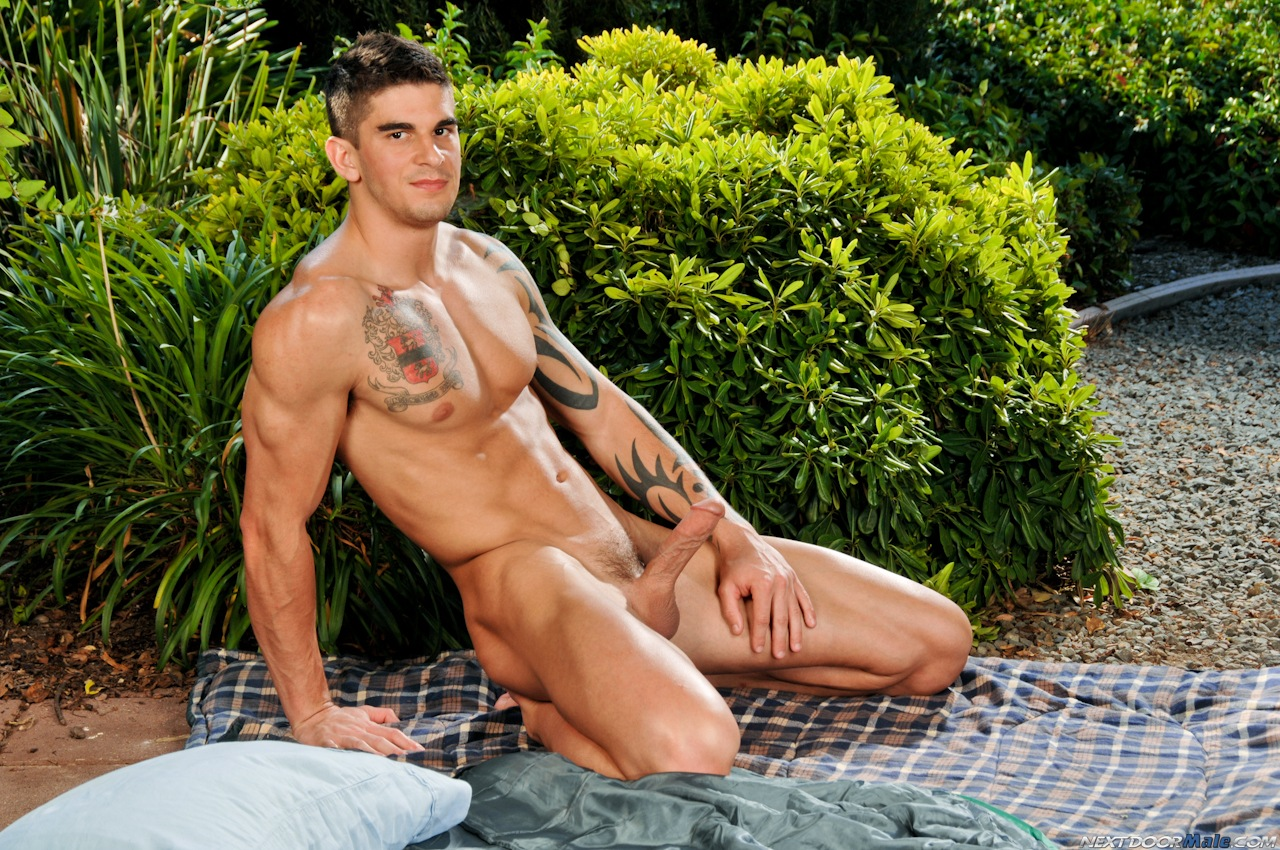 Hot stud Tyler Torro posing naked outdoors at Suck A Boner